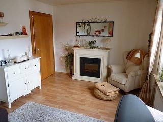 Wohnbereich mit elektrischem Kamin