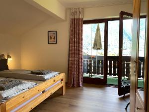 Zimmer 1 mit Balkon und Seeblick | © Thomas und Franziska Wigert