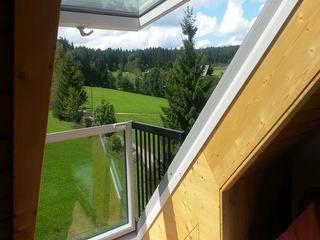 aufgeklappte Dachfensterfront