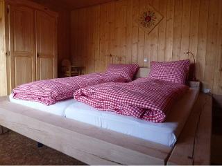Schlafzimmer in der Löwenzahnwohnung auf dem Farnbauernhof