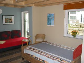 Schlafzimmer mit Sitzecke