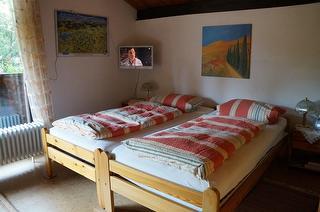 """Doppelzimmer mit Flachbildschirm in dem Haus """"Grüne Idylle"""""""